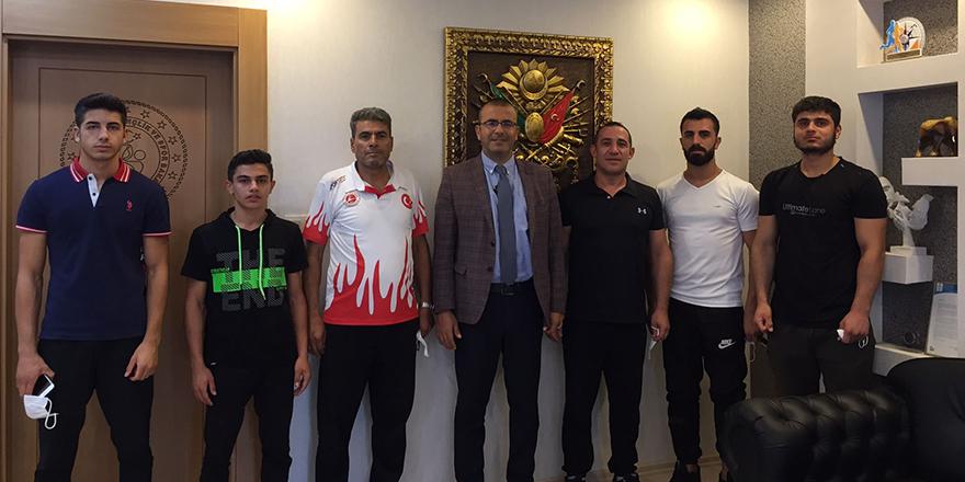 Şampiyon sporculardan Özbay'a ziyaret