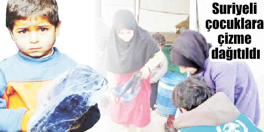 Suriyeli çocuklara çizme dağıtıldı