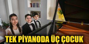 Tek piyanoda üç çocuk