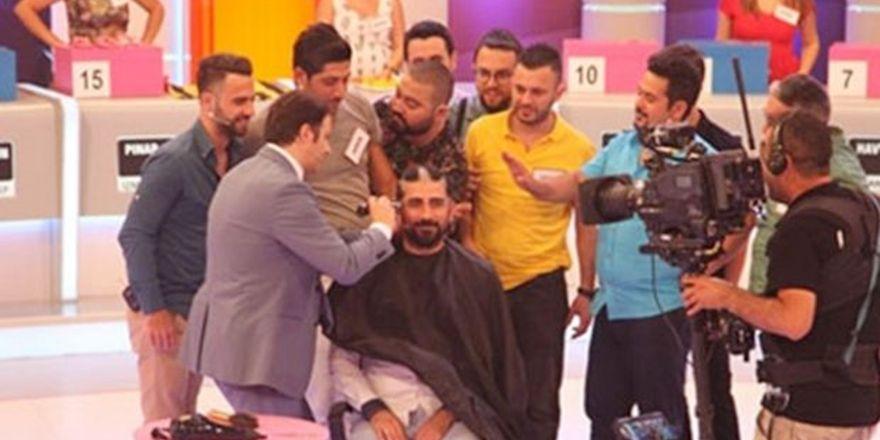 İlker Ayrık yarışmacının saçını kesti